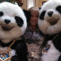two pandas and a person