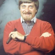 comedian in red sweater