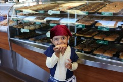 child pirate with donut