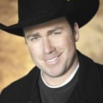 man in black shirt and cowboy hat