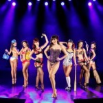 eight pinup girls on stage