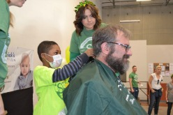 four men getting heads shaved