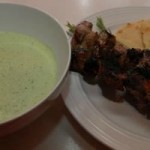 green sauce and lamb on a plate