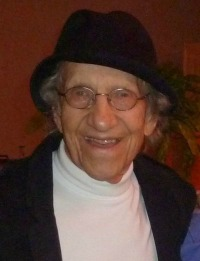 elderly comedian in black hat