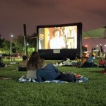 couple on grass watching movie