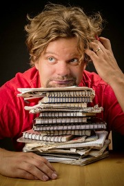 comedian with notebooks