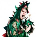 man in dragon suit with dog