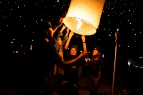 family with lit lanterns