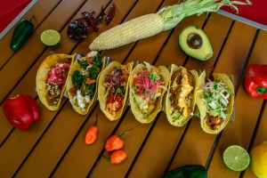 variety of tacos on table