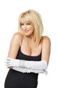 blonde actress in black with white gloves