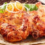 grilled chicken on plate with salad