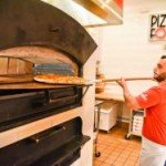 man at pizza oven