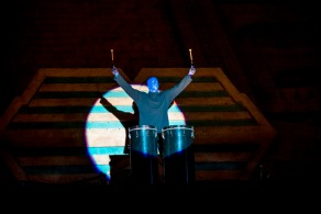 Blue Man in spotlight