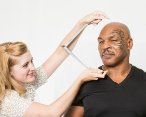 woman measuring Mike Tyson