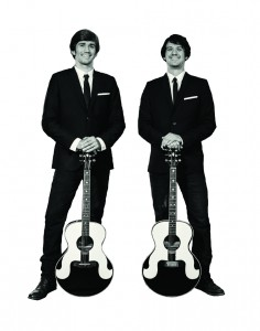 two tall suits with guitars