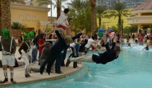 people diving into pool