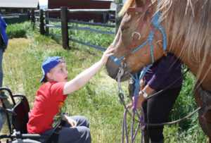 ill boy with horse