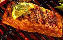 salmon on grill with herbs