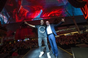 Dj and fan on stage