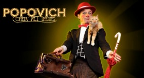 magician with cat on shoulder