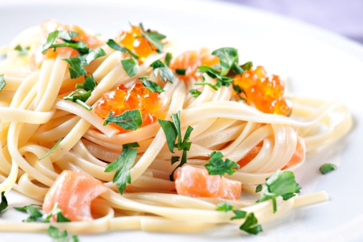 salmon and pasta on plate