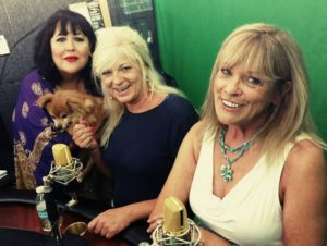 three women and dog in studio