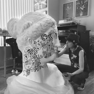 artist and head sculpture
