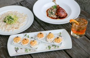 three plates with appetizers