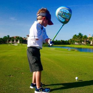 one armed young golfer