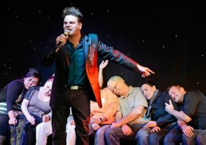 hypnotist on stage with sleepers