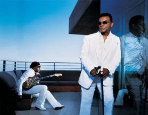 two male singers in white suits