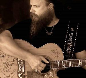 bearded man with guitar