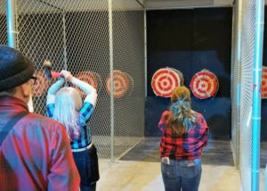 women throwing axes