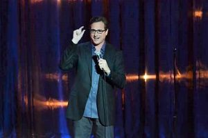 comedian in glasses