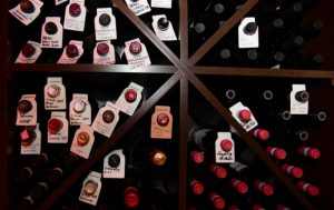 multiple wine bottles with tags