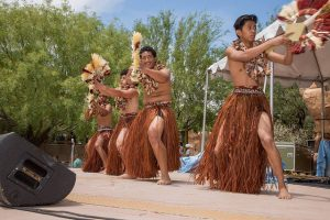 hula dancers in grass skirts