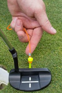 hand with golf device