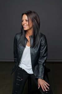 country singer in leather jacket