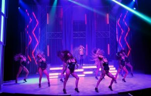 dancers in purple stage