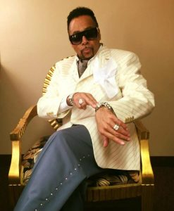 man in white suit and shades