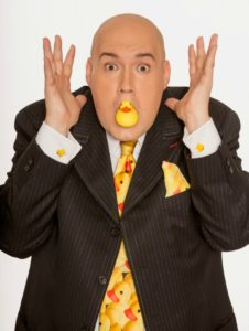comedian with duck in mouth