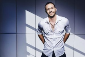 country singer in white shirt