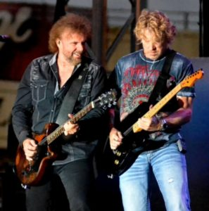 two men with guitars