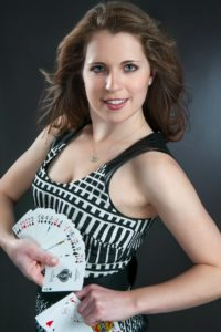 female magician with cards