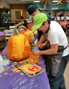 chef carving pumpkin