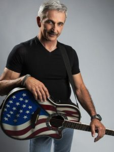 man with patriotic guitar