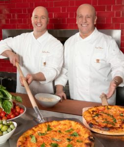 two chefs with pizza