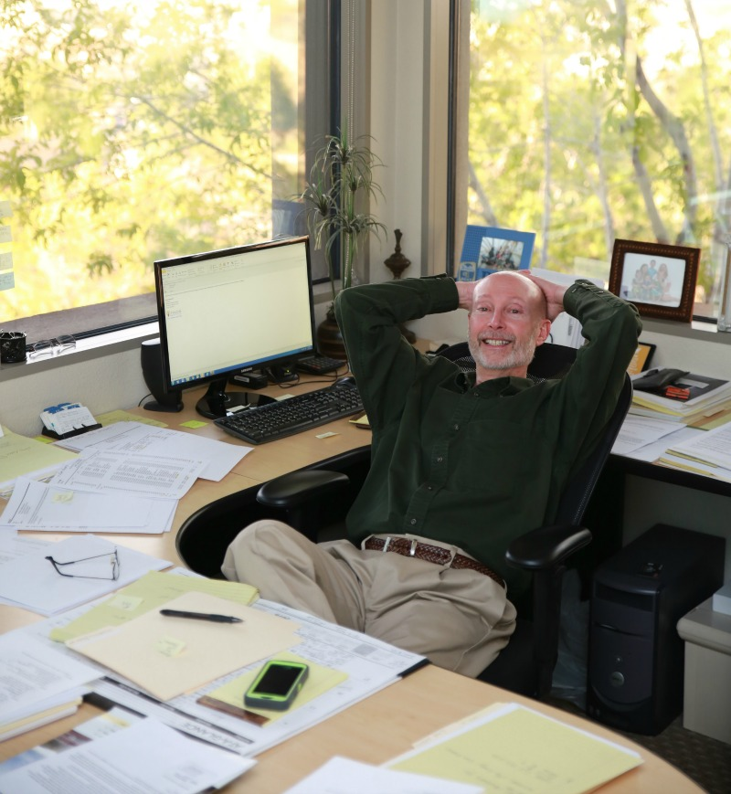 man reclining at desk