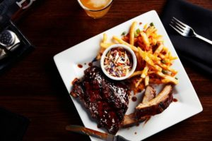 ribs and fries on plate
