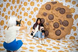 woman and large cookie